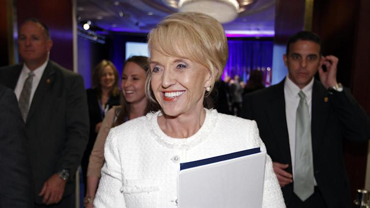 Arizona Gov. Jan Brewer walks during the National Governors Association winter meeting in Washington, Sunday, Feb. 26, 2012. ( AP Photo/Jose Luis Magana)