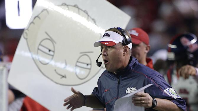Ole Miss coach Hugh Freeze calls in a play in the first half of an NCAA college football game  against Alabama at Bryant-Denny Stadium in Tuscaloosa, Ala., Saturday, Sept. 29, 2012. (AP Photo/Dave Martin)