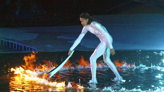 Australian sporting icon Cathy Freeman lights the Olympic cauldron in Sydney to ignite the 27th Olympiad of the modern era, on September 15, 2000