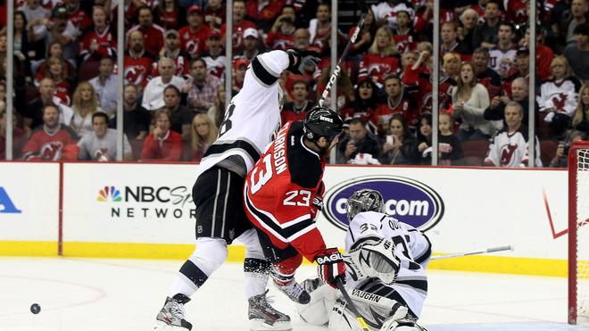 David Clarkson #23 Of The New Jersey Devils Collides With Jonathan Quick #32 And Jarret Stoll #28 Of The Los Angeles  Getty Images