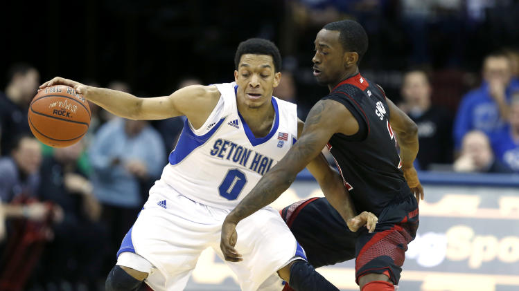 Seton Hall guard Tom Maayan (0) drives against Louisville guard Russ Smith during the first half of an NCAA college basketball game on Wednesday, Jan. 9, 2013, in Newark, N.J. (AP Photo/Julio Cortez)