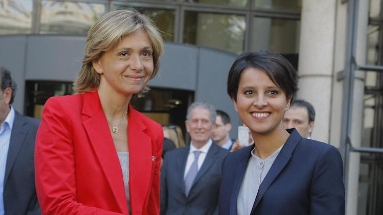 Newly appointed French Women's Rights  Minister and government spokesman Najat Vallaud-Belkacem, right, shakes hands with outgoing Budget minister and spokeswoman Valerie Pecresse,  at their  handover ceremony Thursday May 17, 2012 at the Bercy ministry in Paris.(AP Photo/Jacques Brinon)