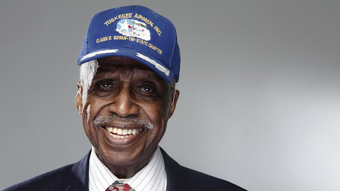 """In this Jan. 10, 2012 photo, Tuskegee airman Theobald G. Wilson poses for a portrait during the """"Red Tails"""" press junket in New York.  """"Red Tails,"""" a film that chronicles the heroism of the Tuskegee Airmen, opens Friday, Jan. 20. (AP Photo/Carlo Allegri)"""