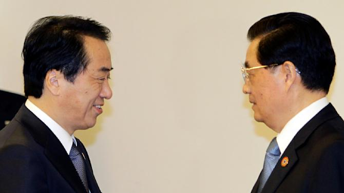 Japanese Prime Minister Naoto Kan, left, and Chinese President Hu Jintao greet each other during their meeting held on the sidelines of the APEC summit in Yokohama, near Tokyo, Saturday, Nov. 13, 2010. Their meeting came amid a territorial dispute that has badly strained ties between the Asian neighbors. (AP Photo/Koji Sasahara, POOL)