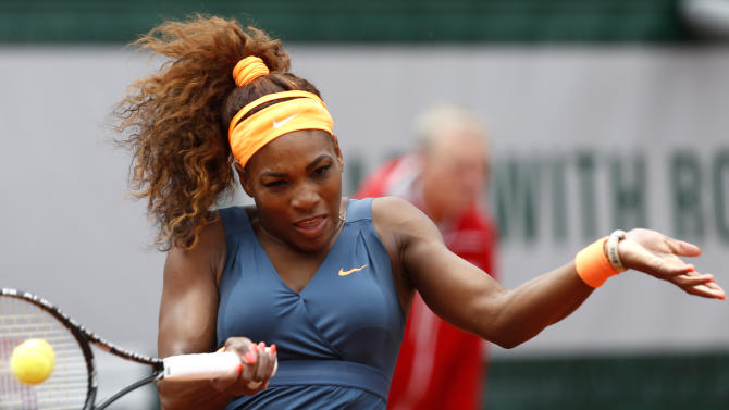Serena Williams, of the USA, returns the ball to Georgia's Anna Tatishvili during their first round match of the French Open tennis tournament at the Roland Garros stadium Sunday, May 26, 2013 in Paris. (AP Photo/Petr David Josek)