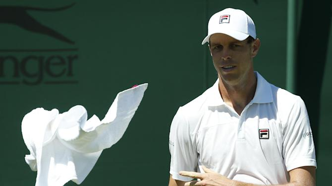 Sam Querrey of the United States throws a towel to a ball boy during the men's singles first round match against Igor Sijsling of the Netherlands at the All England Lawn Tennis Championships in Wimbledon, London, Tuesday June 30, 2015. (AP Photo/Alastair Grant)