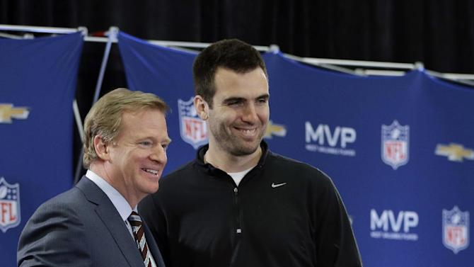 NFL Commissioner Roger Goodell poses for a photo with MVP Baltimore Ravens quarterback Joe Flacco at a news conference after NFL Super Bowl XLVII football game Monday, Feb. 4, 2013, in New Orleans. The Ravens defeated the San Francisco 49ers 34-31. (AP Photo/Darron Cummings)