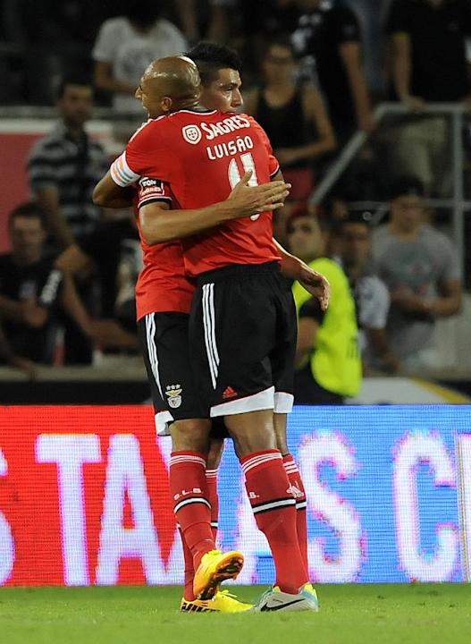 Benfica's Luisao, right, celebrates with Oscar Cardozo, left, after their victory over Vitoria Guimaraes in a Portuguese League soccer match at D. Afonso Henrique stadium in Guimaraes, Portugal, Sunda