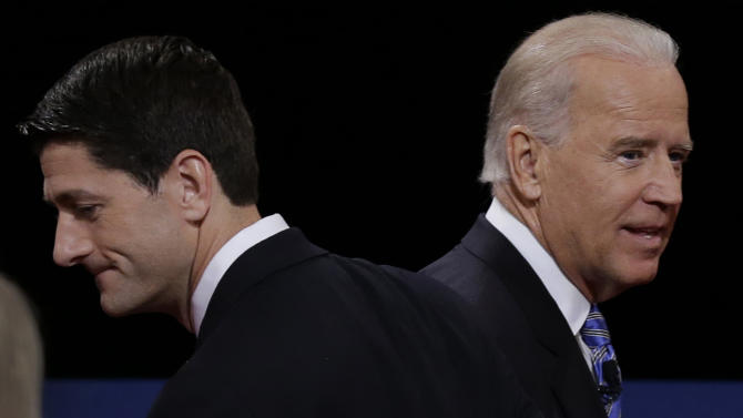 FILE - Republican vice presidential nominee Rep. Paul Ryan of Wisconsin and Vice President Joe Biden pass each other after the vice presidential debate at Centre College, in this Oct. 11, 2012 file photo taken in Danville, Ky. The Supreme Court came up during the debate when moderator Martha Raddatz asked about abortion. The last time the Supreme Court was a real campaign issue was Richard Nixon's law-and-order campaign in 1968. (AP Photo/Charlie Neibergall, File)