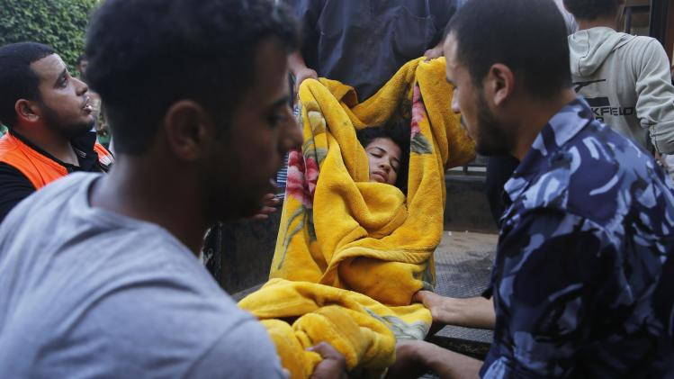 A Palestinian girl, whom medics said was wounded by Israeli shelling, is carried into a hospital at Beit Lahiya in the northern Gaza Strip