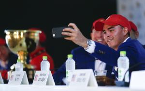 United States' Rickie Fowler takes a selfie photo…