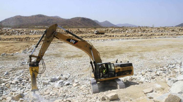 An excavator cracks rocks at the construction site of the Grand Renaissance dam in Guba Woreda, Benishangul Gumuz region