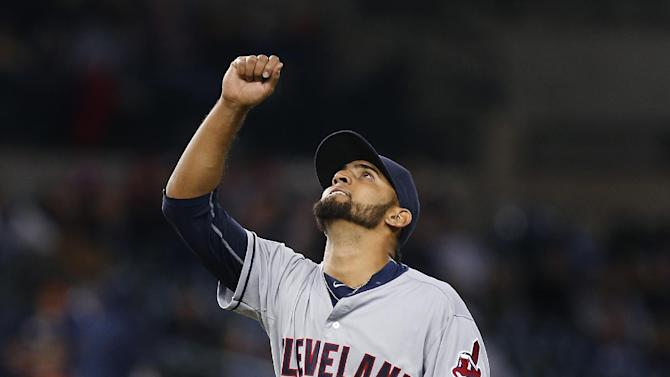 Cleveland Indians pitcher Danny Salazar reacts to the final out in the seventh inning of a baseball game against the Detroit Tigers in Detroit Friday, April 24, 2015. (AP Photo/Paul Sancya)