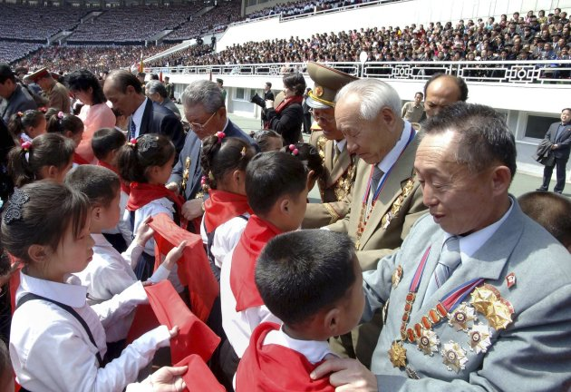 Officials, war veterans and persons of merit put red ties around the necks of children and pin Korean Children's Union (KCU) badges on their chests during a joint national meeting of the Korean Children's Union organizations held to celebrate the 101st birth anniversary of North�s founder Kim Il-Sung in Pyongyang April 12, 2013, in this picture released by the North�s official KCNA news agency on Friday.   REUTERS/KCNA (NORTH KOREA - Tags: POLITICS ANNIVERSARY) ATTENTION EDITORS - THIS PICTURE WAS PROVIDED BY A THIRD PARTY. REUTERS IS UNABLE TO INDEPENDENTLY VERIFY THE AUTHENTICITY, CONTENT, LOCATION OR DATE OF THIS IMAGE. THIS PICTURE IS DISTRIBUTED EXACTLY AS RECEIVED BY REUTERS, AS A RVICE TO CLIENTS. NO THIRD PARTY SALES. NOT FOR USE BY REUTERS THIRD PARTY DISTRIBUTORS