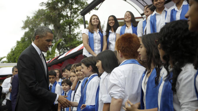 President Barack Obama, left, greets young performers after attending a cultural event at the Casa Amarrilla with Costa Rica's President Laura Chinchilla in San Jose, Costa Rica, Friday, May 3, 2013. (AP Photo/Pablo Martinez Monsivais)