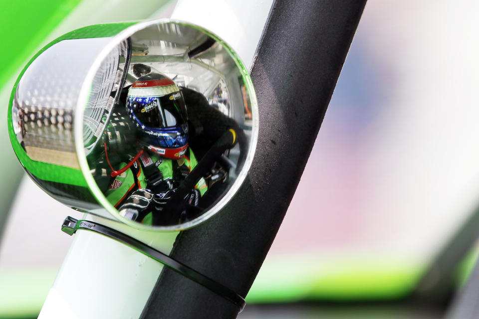 Danica Patrick is reflected in her side mirror during practice for the NASCAR Sprint Cup Series Coca-Cola 600 auto race in Concord, N.C., Saturday, May 26, 2012. (AP Photo/Terry Renna)