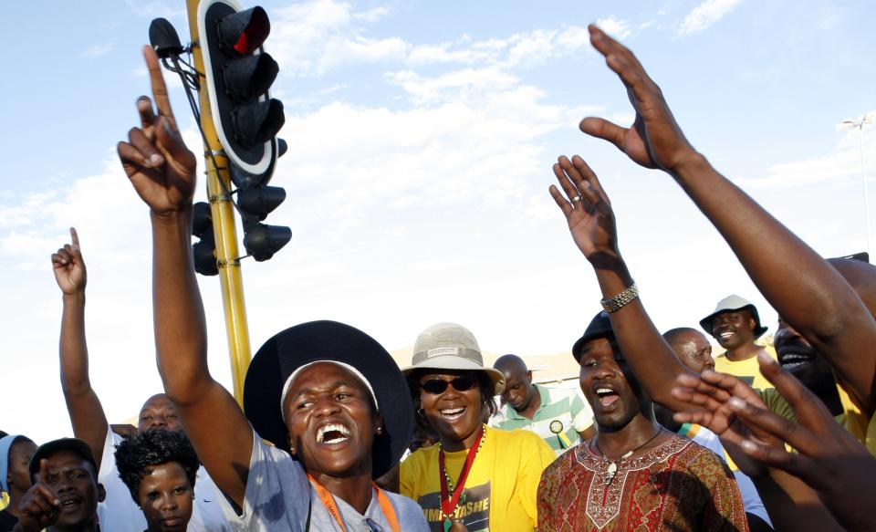 Members of the ruling party African National Congress (ANC) sing and dance outside the venue of their elective conference at the University of the Free State in Bloemfontein, South Africa, on Monday, Dec. 17, 2012. (AP Photo/Themba Hadebe)