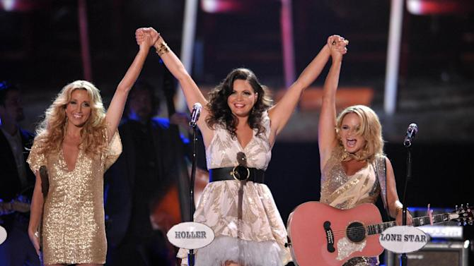 """FILE - This June 2, 2012 file photo shows, from left, Ashley Monroe, Angaleena Presley and Miranda Lambert of Pistol Annies at the 2012 CMT Music Awards in Nashville, Tenn.  The female group released their new album, """"Annie Up,"""" on Tuesday. (Photo by John Shearer/Invision/AP, file)"""