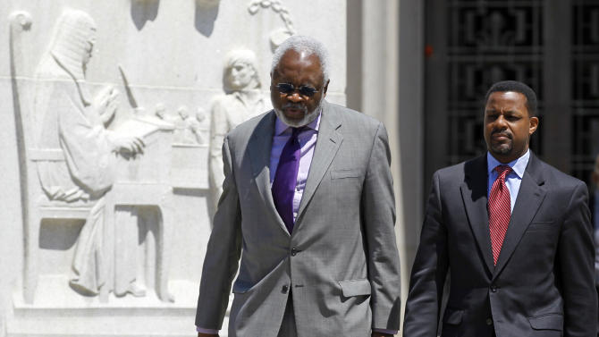 Former Washington, D.C. City Council Chairman Kwame Brown, right, accompanied by his attorney Frederick D. Cooke Jr., leaves federal court in Washington, Friday, June 8, 2012, before speaking after Brown pleaded guilty to federal bank fraud. (AP Photo/Haraz N. Ghanbari)