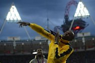 Jamaica's gold medalist Usain Bolt gestures after the podium ceremony of the men's 100m at the athletics event of the London 2012 Olympic Games