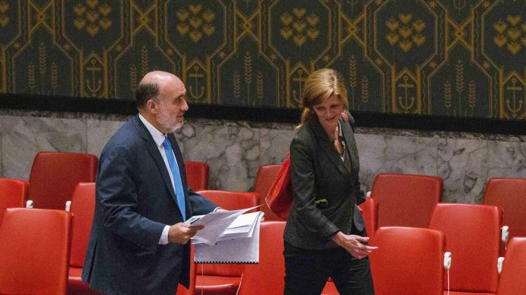 Israel's U.N. Ambassador Ron Prosor attempts to show photos to U.S. Ambassador to the U.N. Samantha Power after a meeting of the Security Council at the headquarters in New York