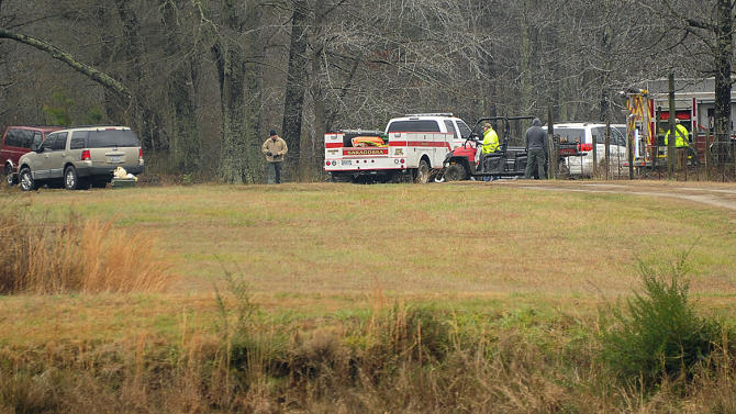 National Transportation Safety Board officials continue to investigate at the scene of a fatal crash Tuesday night of a small plane that was reported stolen near Jasper, Ala., Wednesday, Jan. 2, 2013. Walker County sheriff's Chief Deputy James Painter says authorities are still investigating but believe the teenagers took the plane without permission before it crashed Tuesday night. (AP Photo/AL.com, Joe Songer) MAGS OUT