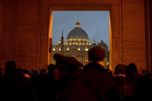 People gather in front of Saint Peter's dome at the Vatican on February 11, 2013