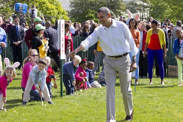 President Barack Obama and his family attend the opening of the Easter Egg Roll festivities at the White House in Washington, Monday, April 9, 2012. From left are President Obama, Malia Obama, first l