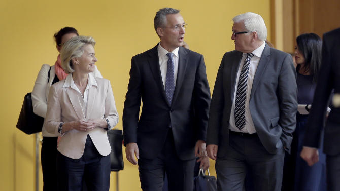 German Defense Minister Ursula von der Leyen, left, German Foreign Minister Frank-Walter Steinmeier, right, and Jens Stoltenberg, Secretary General of the North Atlantic Treaty Organization, NATO, center, arrive for a photo call in Berlin, Germany, Tuesday, June 30, 2015 prior to a reception to mark the 60th anniversary of Germany's accessing to the NATO. (AP Photo/Michael Sohn)