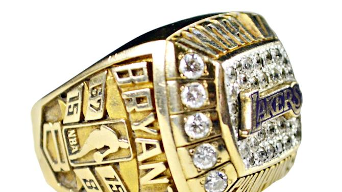 This image provided by Goldin Auctions on Friday, May 3, 2013, shows a team issued Kobe Bryant 2000 Los Angeles Lakers championship ring given by Kobe to his father Joe Bryant. Goldin Auctions is suing for the right to sell the stuff after the NBA star's lawyers wrote the firm to say it could not. Bryant contends that his mother, Pamela Bryant, doesn't have the right to sell the collectibles including his high school letters, a 2000 NBA championship ring and hundreds of other items. (AP Photo/Goldin Auctions)