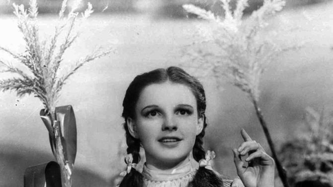 "FILE - In this 1939 file photo provided by Warner Bros., Judy Garland portrays Dorothy in a scene from ""The Wizard of Oz."" Garland's original costume from ""The Wizard of Oz""  will be up for sale at Julien's Auctions in November 2012.  (AP Photo/Warner Bros., file)"