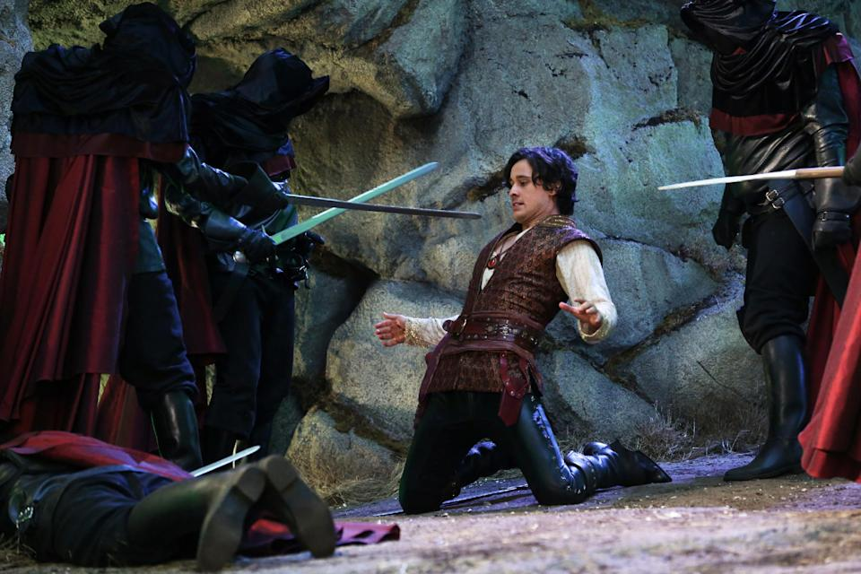 "This publicity photo released by ABC shows Peter Gadiot, center, as Cyrus, in a scene from ""Once Upon a Time in Wonderland,"" produced by ABC Studios. (AP Photo/ABC, Jack Rowand)"