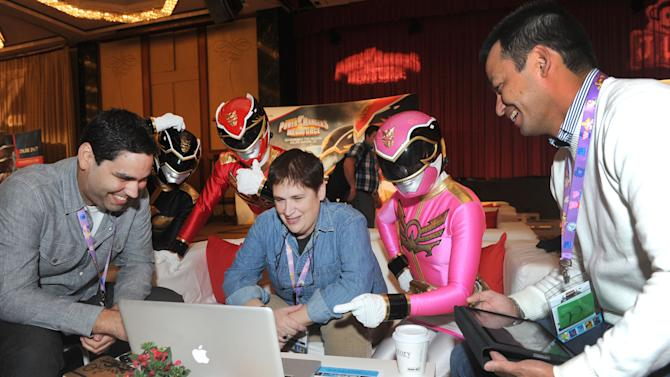 IMAGE DISTRIBUTED FOR SABAN BRANDS - The Power Rangers Megaforce mingle with delegates in attendance at the three day Kidscreen Summit, Tuesday, Feb. 5, 2013, at the Hilton New York. Saban Brands is celebrating the 20th anniversary of the Power Rangers franchise at the conference. (Diane Bondareff/Invision for Saban Brands/AP Images)