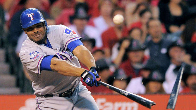 """FILE - In this June 12, 2012, file photo, Texas Rangers' Nelson Cruz breaks his bat while hitting a double during the second inning of their baseball game against the Los Angeles Angels in Anaheim, Calif. Major League Baseball says it is """"extremely disappointed"""" about a new report that says records from an anti-aging clinic in the Miami area link Alex Rodriguez and other players to the purchase of performance-enhancing drugs. The Miami New Times said in a story Tuesday, Jan. 29, 2013, that it had obtained files through an employee at a recently closed clinic called Biogenesis. Other players named by the publication as appearing in the records include Cruz, Melky Cabrera, Gio Gonzalez and Bartolo Colon. (AP Photo/Mark J. Terrill, File)"""