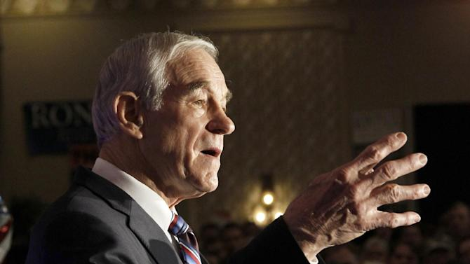 Republican presidential candidate Rep. Ron Paul, R-Texas, addresses the crowd  during the North Dakota caucus Tuesday, March 6, 2012, in Fargo, N.D. (AP Photo/Charles Rex Arbogast)