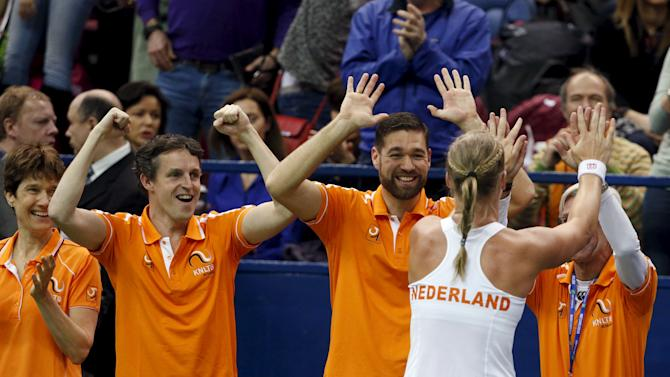 Kiki Bertens of the Netherlands celebrates with team-mates after winning her Fed Cup World Group tennis match against Russia's Ekaterina Makarova in Moscow