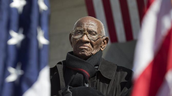 Richard Overton the oldest living WWII veteran, listens during a Veterans Day ceremony attended by President Barack Obama, commemorating Veterans Day, Monday, Nov. 11, 2013, at Arlington National Cemetery in Arlington, Va. The president paid tribute to those who have served in the nation's military, including one of the nation's oldest veterans, the 107-year-old Overton of East Austin, Texas. (AP Photo/Manuel Balce Ceneta)