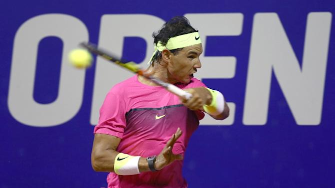 Rafael Nadal of Spain returns the ball to Argentina's Facundo Arguello during their ATP Argentina Open singles match, in Buenos Aires, on February 25, 2015