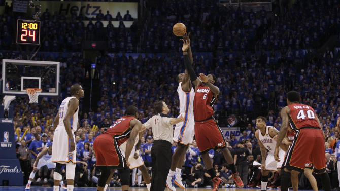 Oklahoma City Thunder center Kendrick Perkins (5) and Miami Heat small forward LeBron James  take the tip off to begin Game 1 of the NBA finals basketball series, Tuesday, June 12, 2012, in Oklahoma City. (AP Photo/Jeff Roberson)