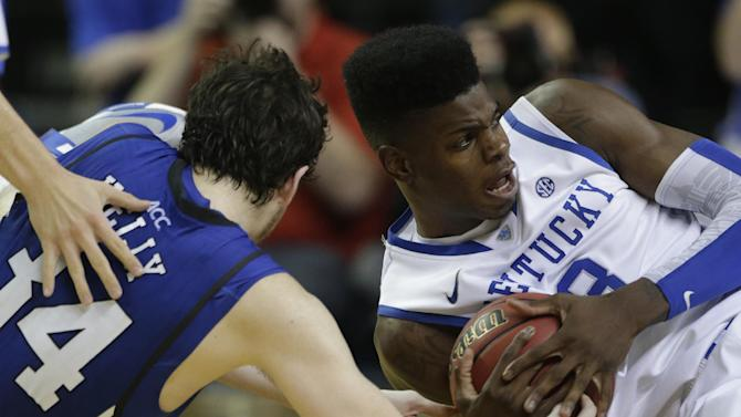 Kentucky forward Nerlens Noel (3) fights for a loose ball with Duke forward Ryan Kelly (34)during the second half of an NCAA college basketball game at the Georgia Dome in Atlanta Tuesday, Nov. 13, 2012. Duke beat Kentucky 75-68. (AP Photo/Dave Martin)
