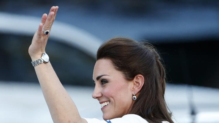 Britain's Catherine, Duchess of Cambridge waves to the crowds at a walk about in Brisbane