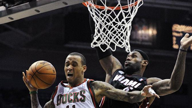 FILE - In this Dec. 29, 2012, file photo, Milwaukee Bucks' Monta Ellis (11) drives to the basket against Miami Heat's LeBron James during the second half of an NBA basketball game in Milwaukee. The Bucks won 104-85. Winners of 20 games in a row, the Heat could be headed toward history. The Bucks, who host the Heat on March 15, 2013, are one team looking for their opportunity to stop the streak. (AP Photo/Jim Prisching, File)