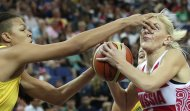 Australia's Elizabeth Cambage jams her finger into the eye of Russia's Natalya Vodopyanova while defending a drive to the basket during a women's bronze medal basketball game at the 2012 Summer Olympics, Saturday, Aug. 11, 2012, in London. (AP Photo/Charles Krupa)