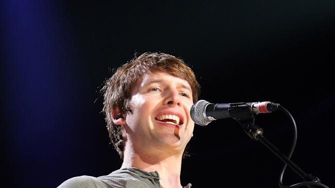 """FILE - In this Sunday, April 3, 2011 file photo British singer-songwriter James Blunt performs on stage at """"Le Liberte"""" in Rennes, western France. James Blunt was among 17 hacking victims who settled Friday Feb. 8, 2013 with News Corp. subsidiary News Group Newspapers over its campaign of illegal espionage, which set off a massive scandal when it was revealed in July 2011. (AP Photo/David Vincent, File)"""