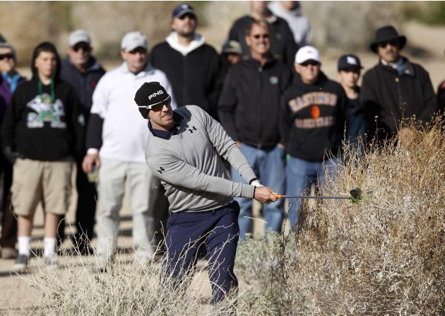 Mahan of the U.S. hits out of the bushes on the 17th hole during the championship match of the WGC-Accenture Match Play Championship golf tournament in Marana