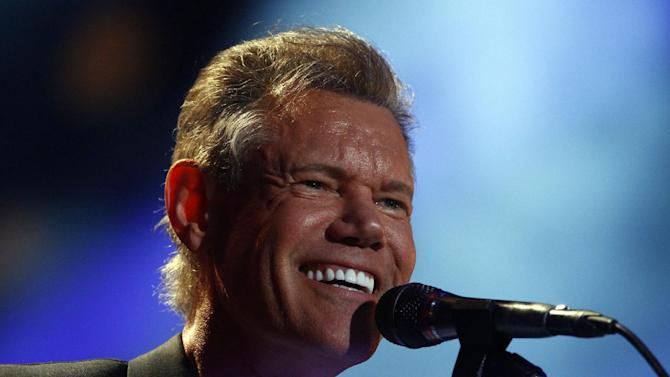 FILE - In this June 7, 2013 file photo, Randy Travis performs on day 2 of the 2013 CMA Music festival at the LP Field in Nashville, Tenn. Publicist Kirt Webster on Wednesday night, July 10, 2013 said that the 54-year-old Travis is in surgery after suffering a stroke while he was being treated for congestive heart failure because of a viral illness. (Photo by Wade Payne/Invision/AP, File)