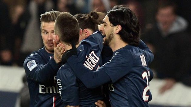Paris Saint-Germain's English midfielder David Beckham (C) and Paris Saint-Germain's French midfielder Jeremy Menez celebrate after Paris Saint-Germain's French forward Kevin Gameiro scored against Montpellier (AFP)