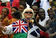 Jimmy Savile, a television and radio celeberity joins in with people representing Commonwealth countries wearing their tradional dress during Golden Jubilee celebrations in London in 2004. The former head of the BBC on Wednesday denied any role in shelving an investigation into allegations of widespread abuse of underage girls by Savile