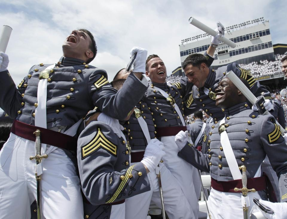 Cadets react at the conclusion of a graduation and commissioning ceremony at the U.S. Military Academy in West Point, N.Y., on Saturday, May 21, 2011.   (AP Photo/Mike Groll)
