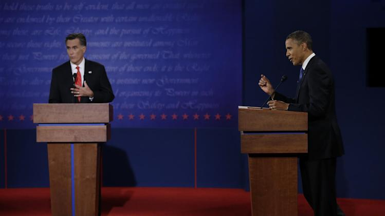 Republican presidential nominee Mitt Romney, left, and President Barack Obama speak during the first presidential debate at the University of Denver, Wednesday, Oct. 3, 2012, in Denver. (AP Photo/Eric Gay)